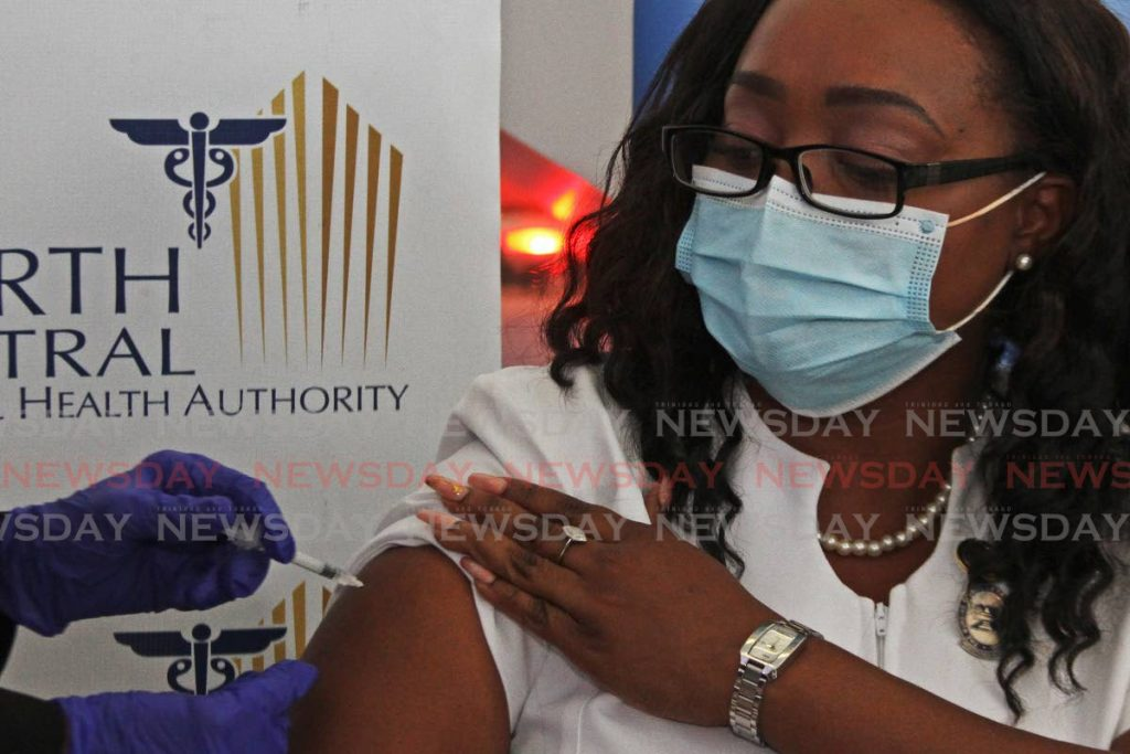 Caura Hospital's infection prevention and control nurse Keisha Prevatt-Gomez  is one of the first frontline workers to recieve the covid19 vaccine at the Couva Hospital and Multi-Training Facility. - Marvin Hamilton