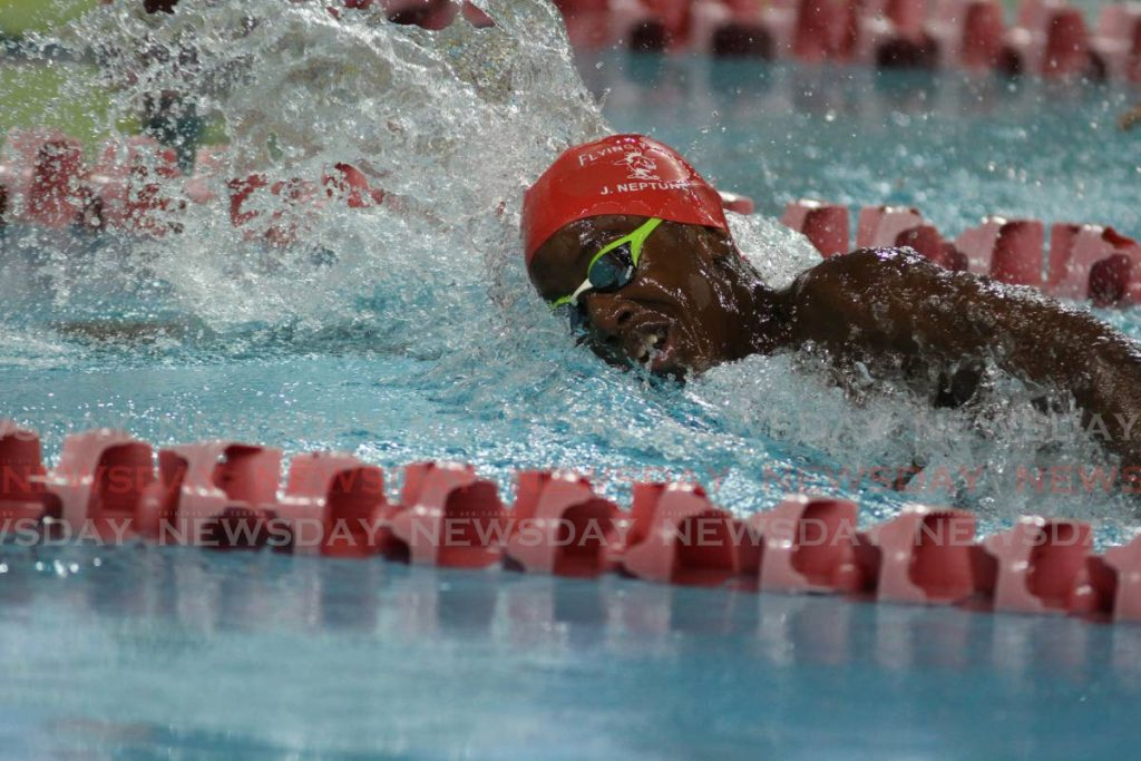 Jamal Neptune participates in the 100m freestyle on Friday at the National Age Group Long Course Championships at the National Aquatic Centre, Couva.  - Marvin Hamilton