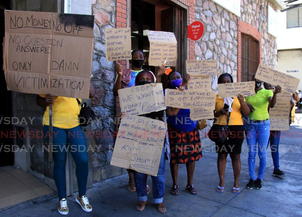 Workers of the Centre for Socially Displaced Persons (CSDP) protest over on Independence Square, Port of Spain, Wednesday.  Photo by Ayanna Kinsale