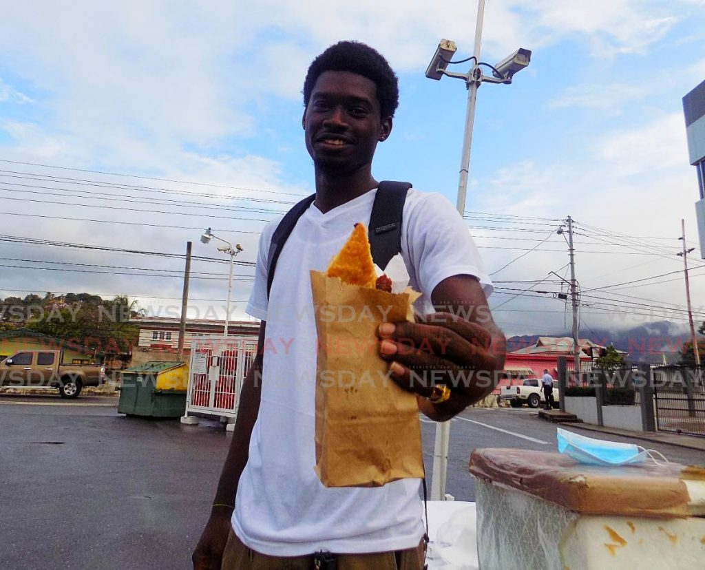 Pie vendor Tyrell Auguste sells his pastries to workers on the go at the NP gas station on Eighth Avenue, Barataria. PHOTOS BY SHANE SUPERVILLE -
