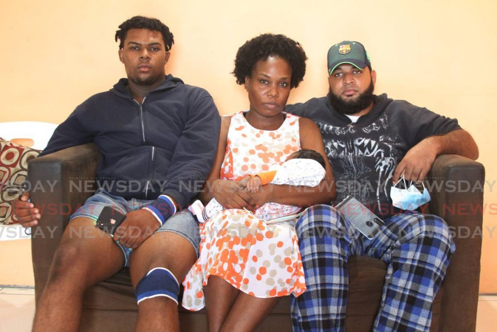 Kurton Chichester, his cousin Jineal Chichester and her common-law husband Analdo Ramjitsingh. - Marvin Hamilton