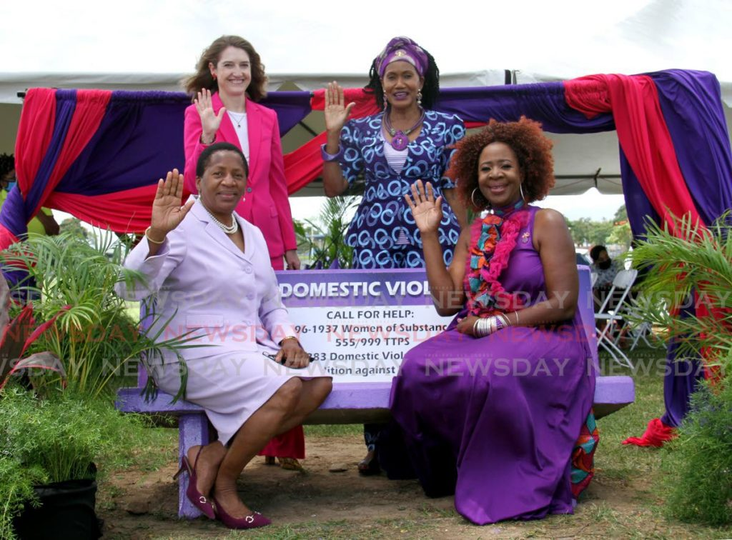Minister of Housing and Urban Development Penelope Beckles, seated left, Women of Substance president Onika Mars, British High Commissioner to Trinidad and Tobago Harriet Cross, standing left, and Women of Substance director Jennifer Baptiste-Primus raise their hands in the Choose to Challenge sign at the launch of the Purple Bench initiative at Rose Park, Arima, on Monday. - Ayanna Kinsale