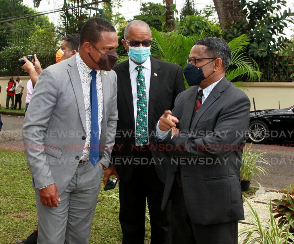 Minister of Foreign and Caricom Affairs Amery Browne, left, is deep in conversation with India's High Commissioner to TT Arun Kumar Sahu as Jamaican High Commissioner to TT Arthur Williams looks on at the unveiling of Commonwealth Garden at Wildflower Park, in St Clair, on Friday. - ROGER JACOB