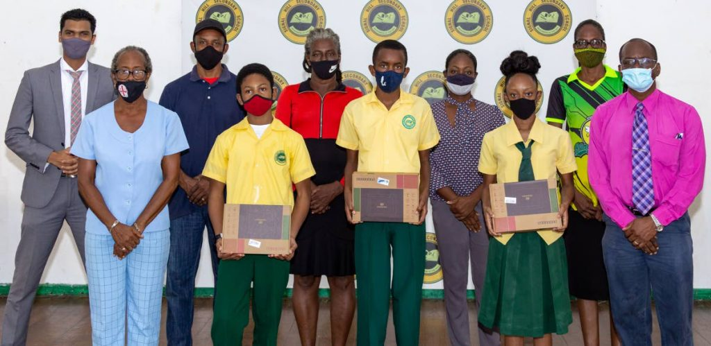 Signal Hill Secondary students (from left) Maleek Elliott, Elijah Hospedales and Stacey Abraham with tablets donated by the Inter-School/Inter Varsity Christian Fellowship on Friday. PHOTO BY DAVID REID  -