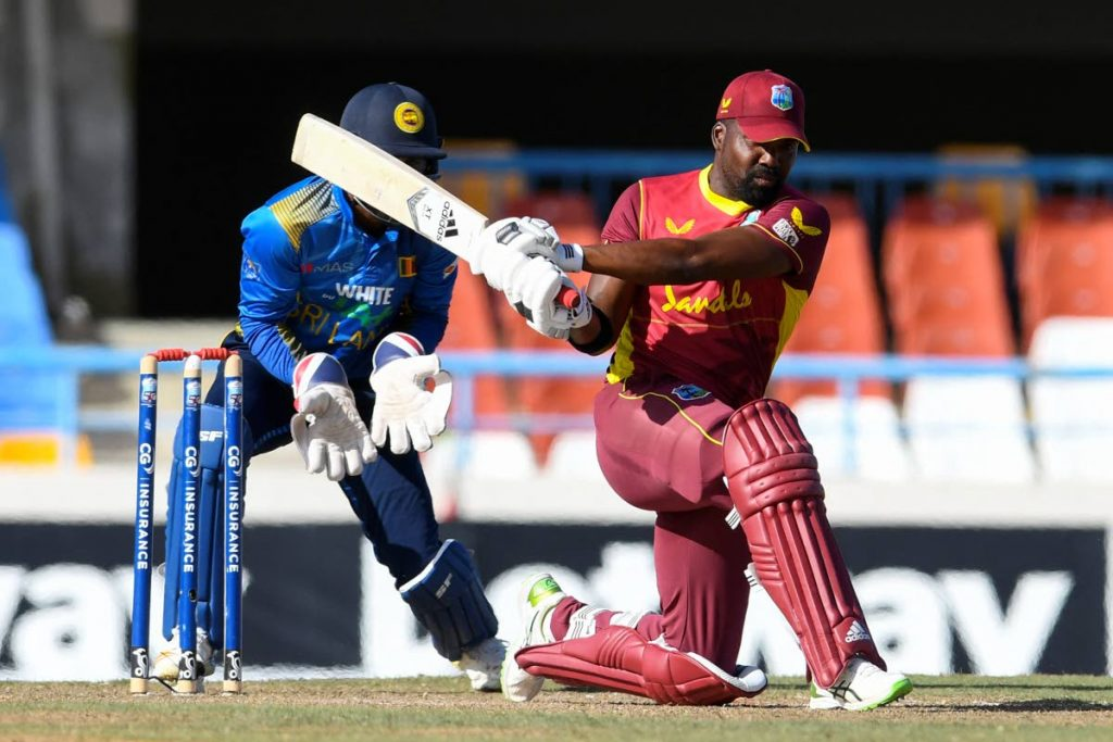West Indies batsman Darren Bravo sweeps the ball for a boundary during the 3rd One-Day International between West Indies and Sri Lanka at the Sir Vivian Richards Cricket Stadium in North Sound, Antigua on Sunday. West Indies won the game by five wickets. (AFP PHOTO) -