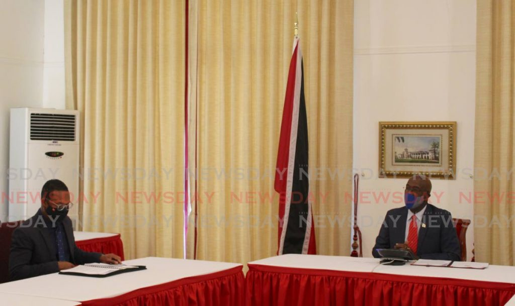 Prime Minister Rowley was joined by Foreign and Caricom Affairs Minister Dr Amery Browne in a teleconference call with China President Xi Jinping. Photo: Office of the Prime Minister - Office of the Prime Minister