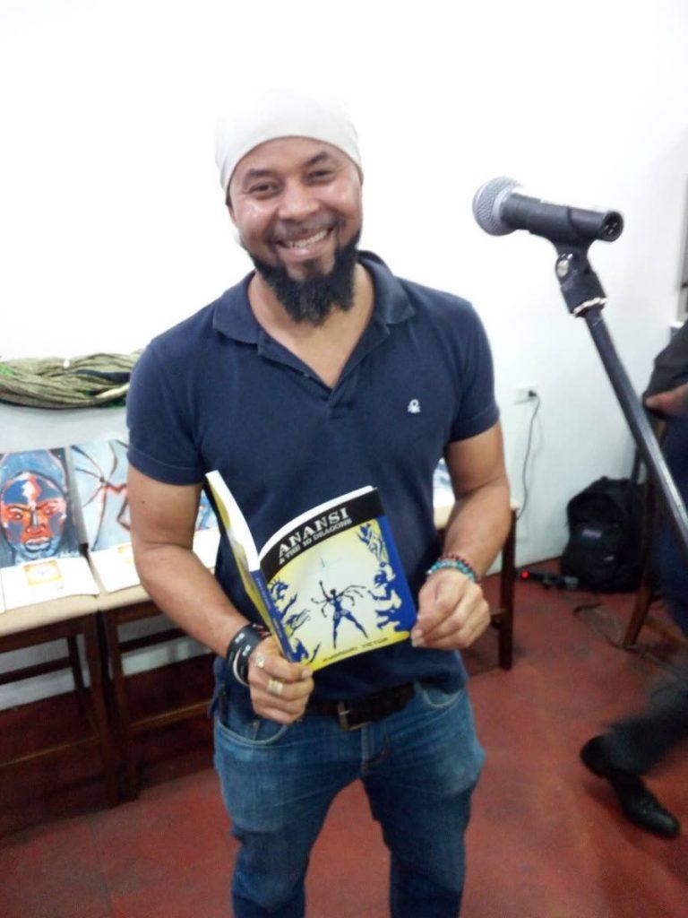 Author Rubadiri Victor with his novel Anansi & the Book of Night.