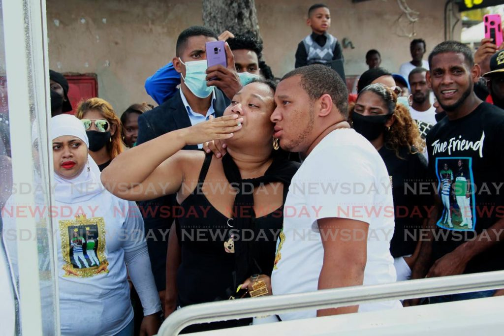 A mourner blows a kiss to deceased Sterling