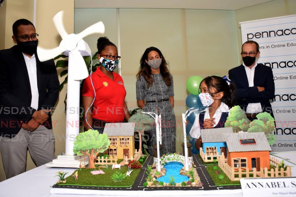 Don Miguel Hindu School student Annabel Sookway, explains her alternative energy project to, from left, Ryan Chaitram of BPTT, Kadijha Watche of STREAM, Kelli-Marie Patel of Shell TT and CEO of Pennacool.com John Devaux  at the Science and Conservation Science Fair award ceremony a the Ministry of Public Utilities in Port of Spain on Friday. Photo by Vidya Thurab