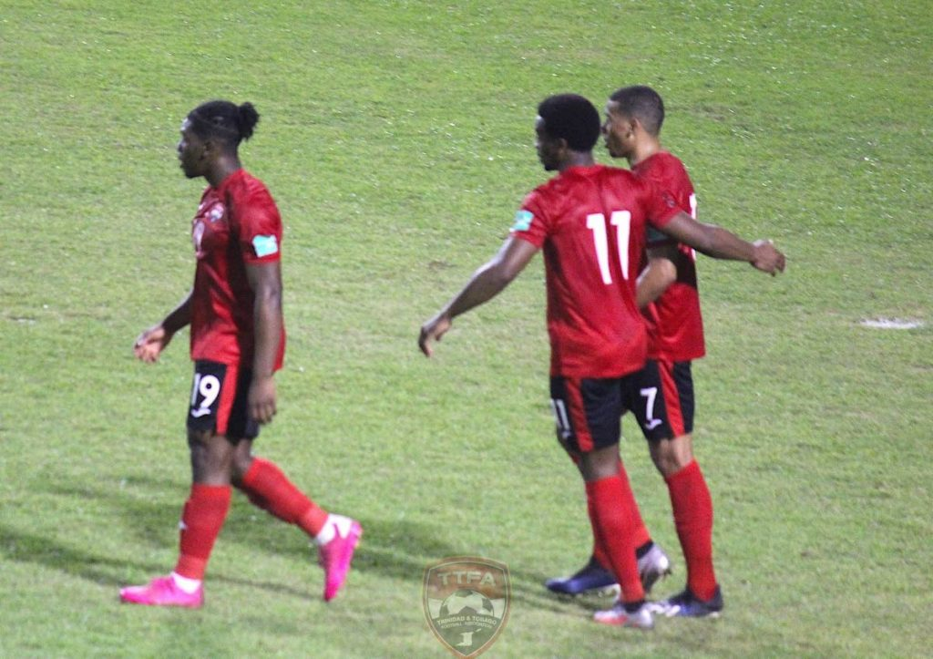 TT's Levi Garcia (centre), with teammates Daniel Phillips (left) and Ryan Telfer during Thursday's 2022 FIFA World Cup qualifier between TT and Guyana at the Santo Domingo, Dominican Republic. PHOTO COURTESY TTFA. -