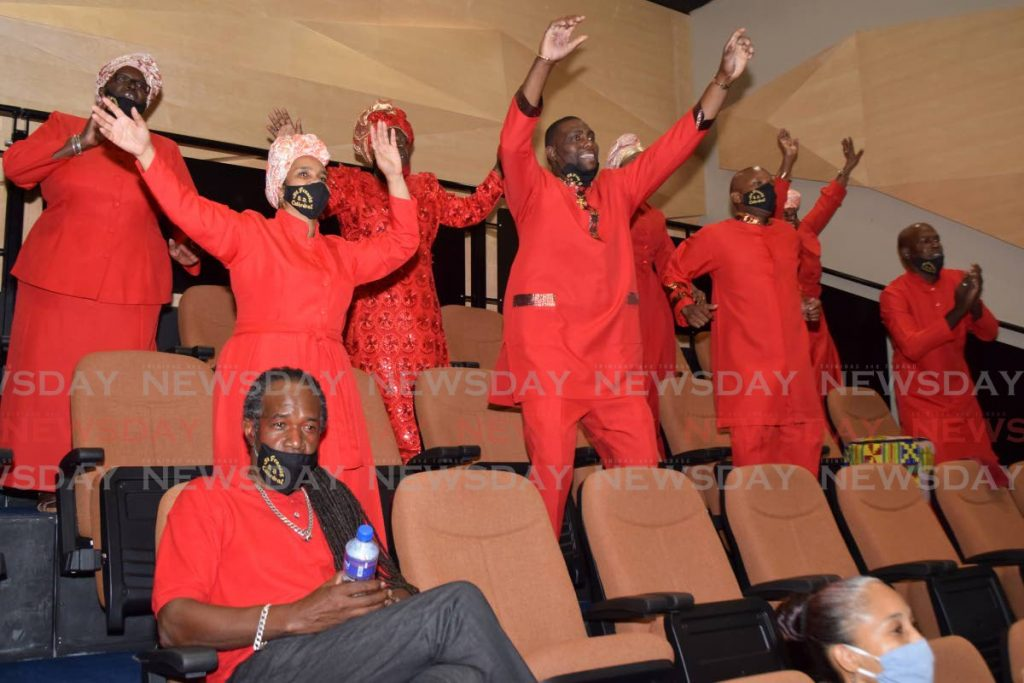 Members of the St Francis Spiritual Baptist Cathedral enjoy performances at the PNM's  Spiritual/Shouter Liberation Day celebrations at Government Campus, Port of Spain on Saturday.  Photo by Vidya Thurab -