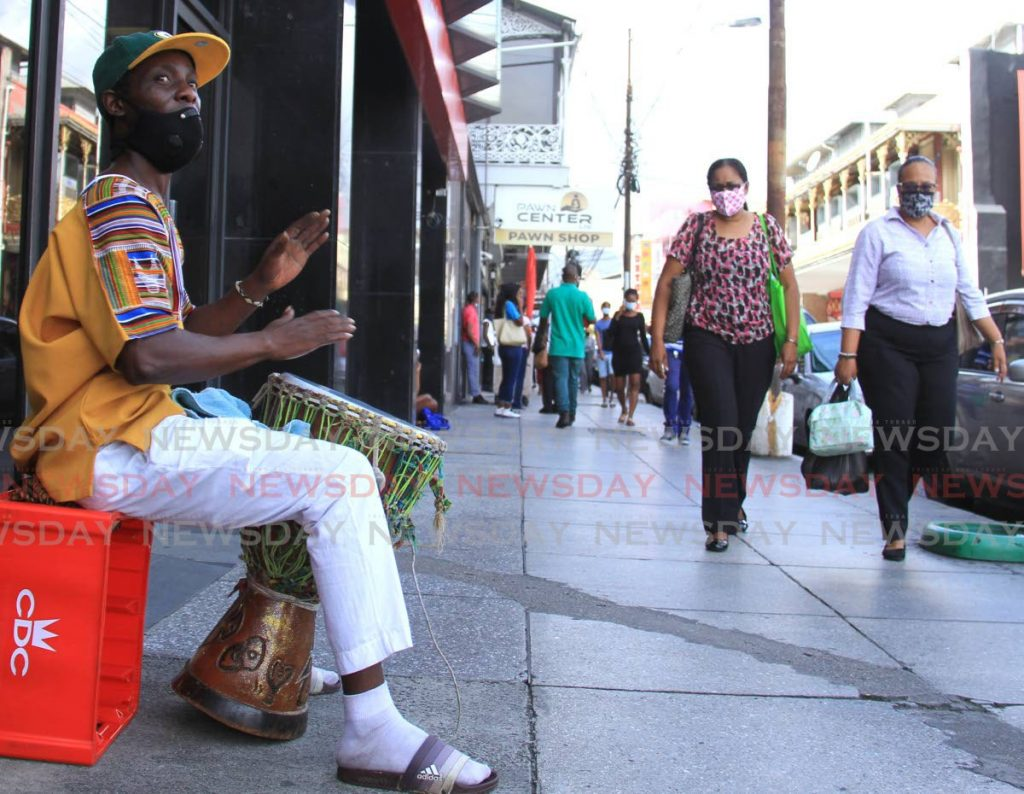 Laventille resident Kevin Griffith entertains passers by while beating his drum on Frederick Street, Port of Spain. Photo by Ayanna Kinsale