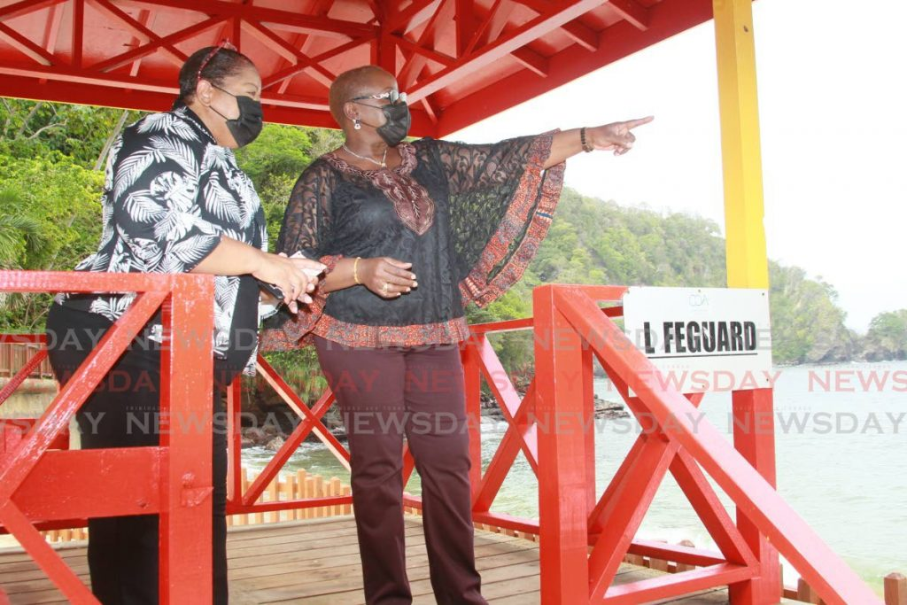 Minister of Planning and Development Camille Robinson-Regis, and the general manager of the Chaguaramas Development Authority (CDA) Karen Clark-Rowley enjoy the view from a lifeguard booth at the Macqueripe Beach facility in Chaguaramas on Wednesday. Photo by Roger Jacob