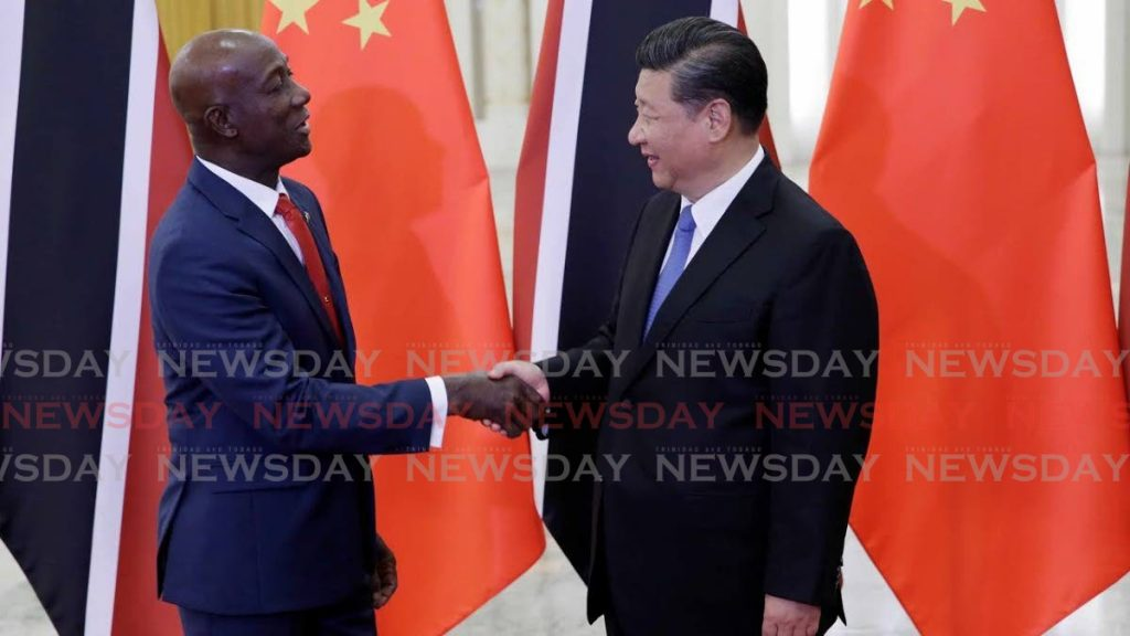 GOOD RELATIONS: China President Xi Jinping and PM Dr Keith Rowley shake hands in 2019 at the Great Hall of the People in Beijing, China. -