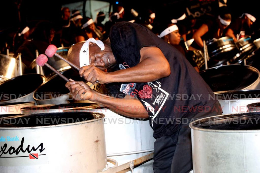 In this file photo an Exodus Steel Orchestra player passionately beats the steel drum. File Photo -SUREASH CHOLAI