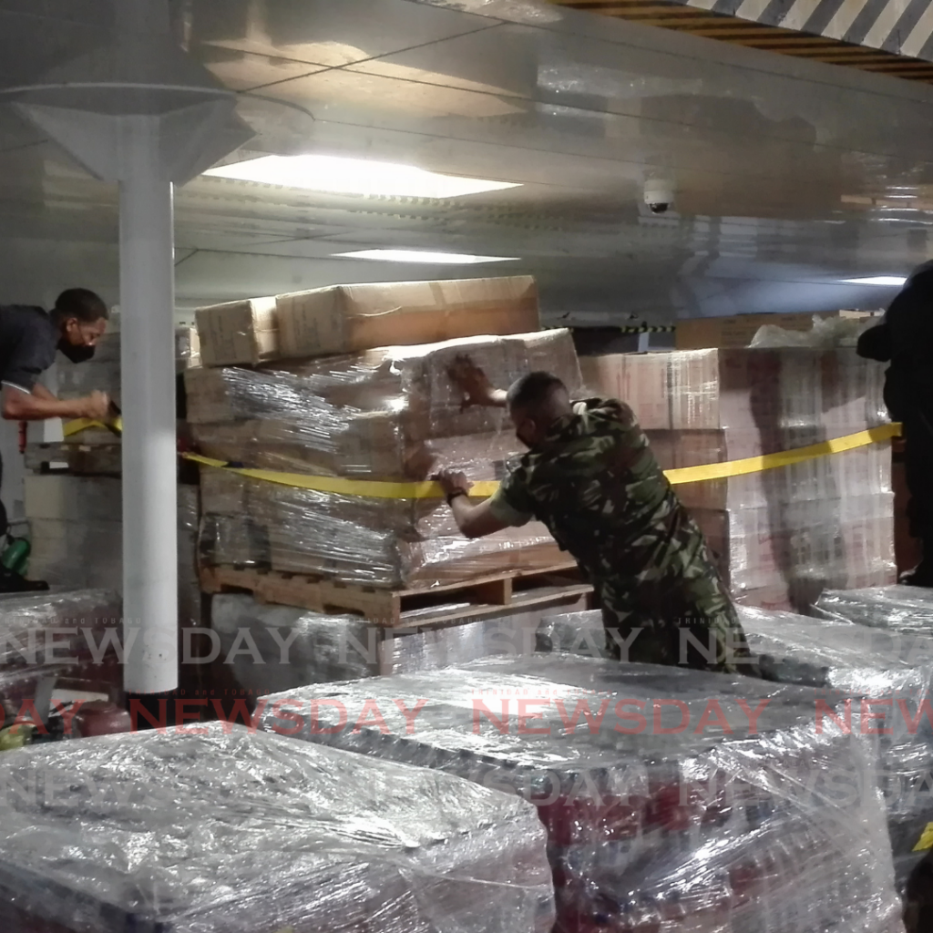 Supplies for St Vincent being loaded on board the MV Galleons Passage before it set sail for the island on Tuesday morning carrying aid and Defence Force troops to assist after the eruption on Friday of the La Soufriere volcano. Photo by Stephon Nicholas.