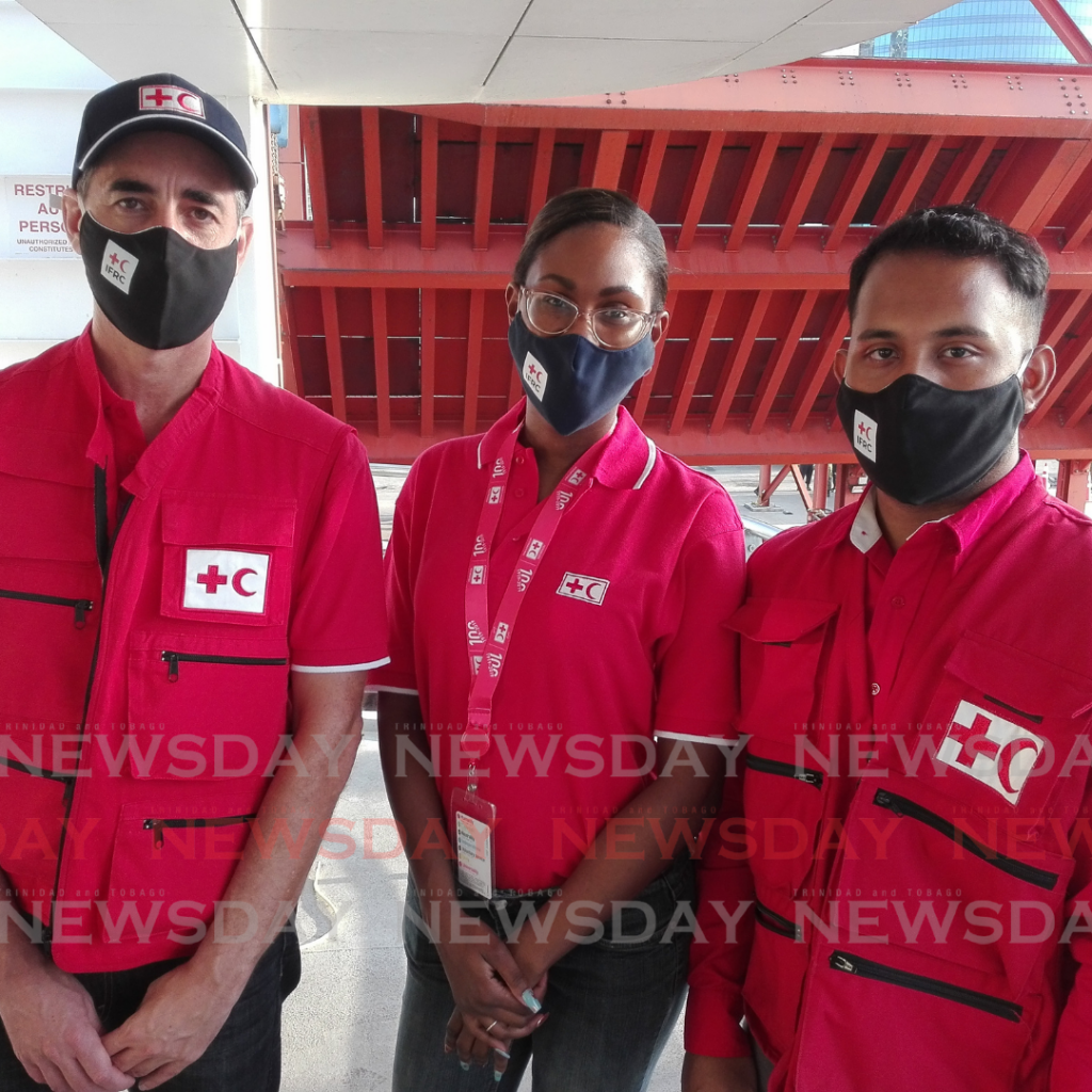 Red Cross members, from left, Ariel Kestens, Rhea Pierre and Arshad Mandol aboard the Galleons Passage on Tuesday morning. Photo by Stephon Nicholas.