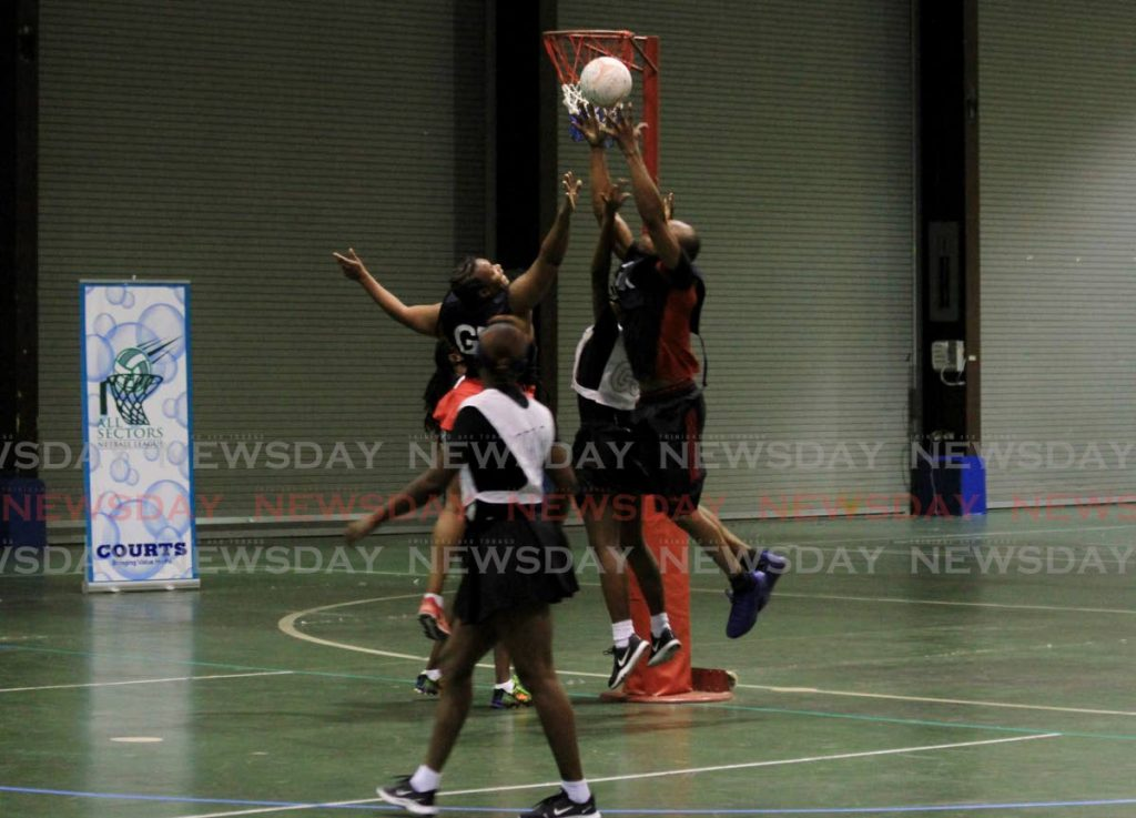 Team Fire players try to secure the ball after Kanika Paul-Payne, centre, of TSTT tries to score during the All Sectors Netball League, Centre of Excellence, Macoya on August 15, 2020. Recreational sports are banned once more owing to a recent surge in covid19 cases. Photo by Ayanna Kinsale -