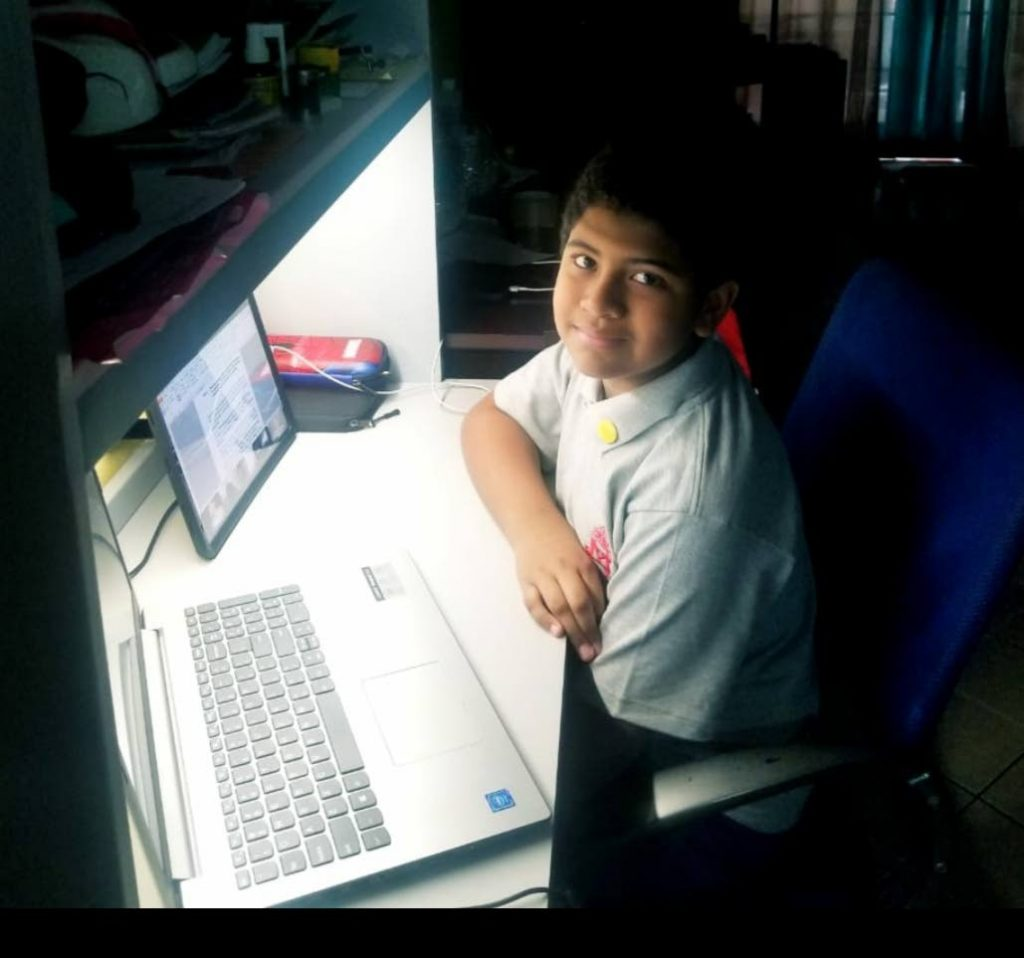 In this 2020 file photo, Maria Regina Grade school student Jeremiah Auguste attends a virtual class at home. Universities must adapt now to attract generation alpha students. Photo courtesy Sasha Creed -