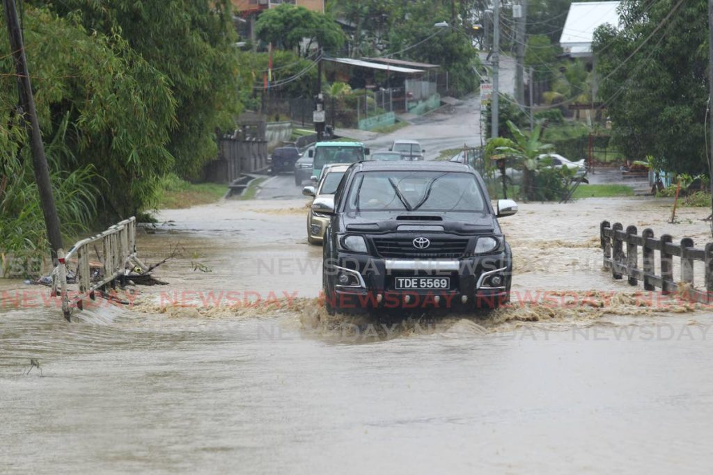 WATER WORLD: Flooding is an issue which occurs annually in TT and the ODPM is warning that disaster preparedness needs to be taken much more seriously by the public. FILE PHOTO/LINCOLN HOLDER -