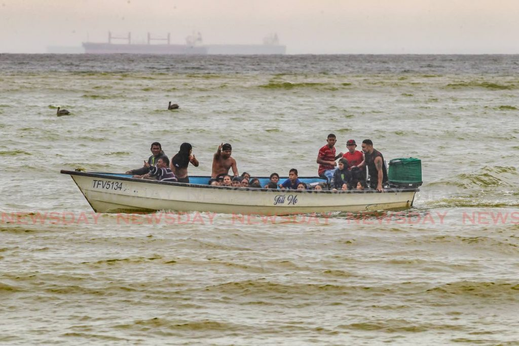 November 2020 file photo of Venezuelans onboard a pirogue making its way to Los Iros beach in TT  - Photo by Lincoln Holder