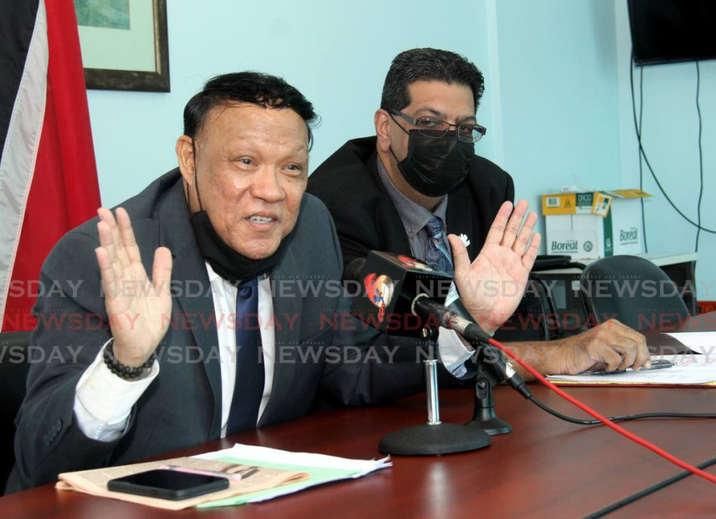 Oppostion MP for Pointe-a-Pierre David Lee speaks during a press conference at the Office of the Opposition Leader on Charles Street, Port of Spain, as Mayaro MP Rushton Paray looks on Sunday. - Ayanna Kinsale