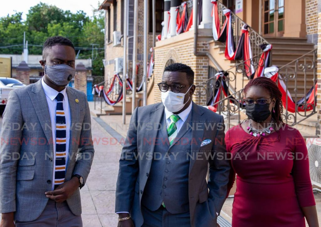 PDP political leader Watson Duke, centre, with deputies Farley Augustine, left, and Dr Faith BYisrael outside the Assembly Legislature, Scarborough. File photo -