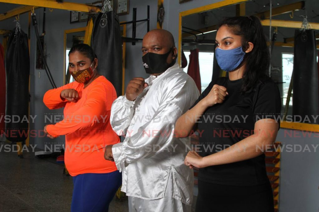 Kung Fu Master Davanand Samaroo teaches self-defence to women at the Davanand Samaroo Kung Fu School, on Coffee Street San Fernando. - Marvin Hamilton
