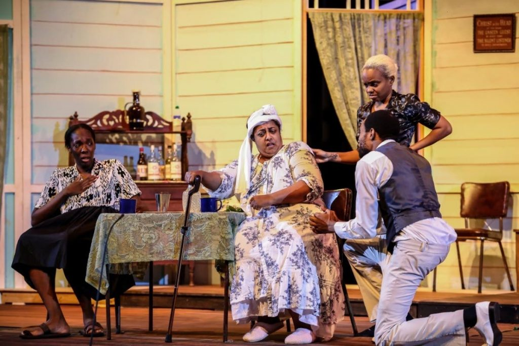 The cast of the Junction Village in a scene from the play staged at the Naparima Bowl last weekend. -