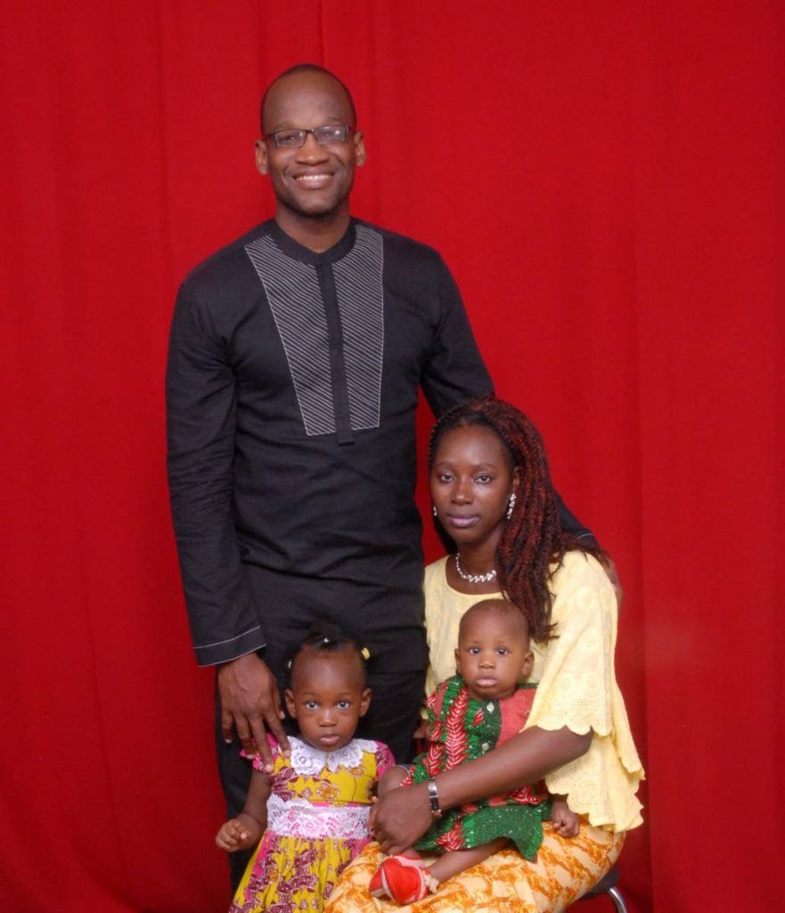 Former UNC senator Taharqa Obika, his wife and their children.  -