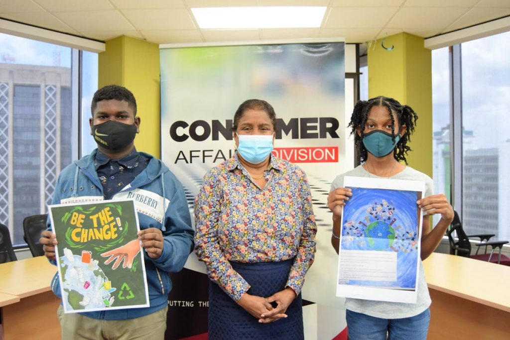Minister of Trade and Industry Paula Gopee-Scoon, centre, is flanked by competition winners Kester Branche, left, and Tahlia Peters  with their winning art pieces.   -