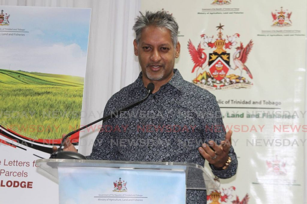 Minister of Agriculture, Land and Fisheries Clarence Rambharat at a lease distribution ceremony at Society Hall Lodge, Marabella last Thursday. - Photo by Marvin Hamilton