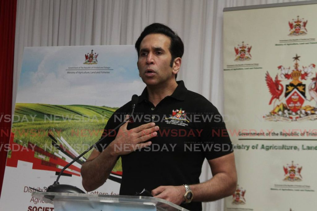 Attorney General Faris Al-Rawi speaking at a lease distribution ceremony held in Marabella at Society Hall Lodge on Wednesday evening. - Photo by Marvin Hamilton
