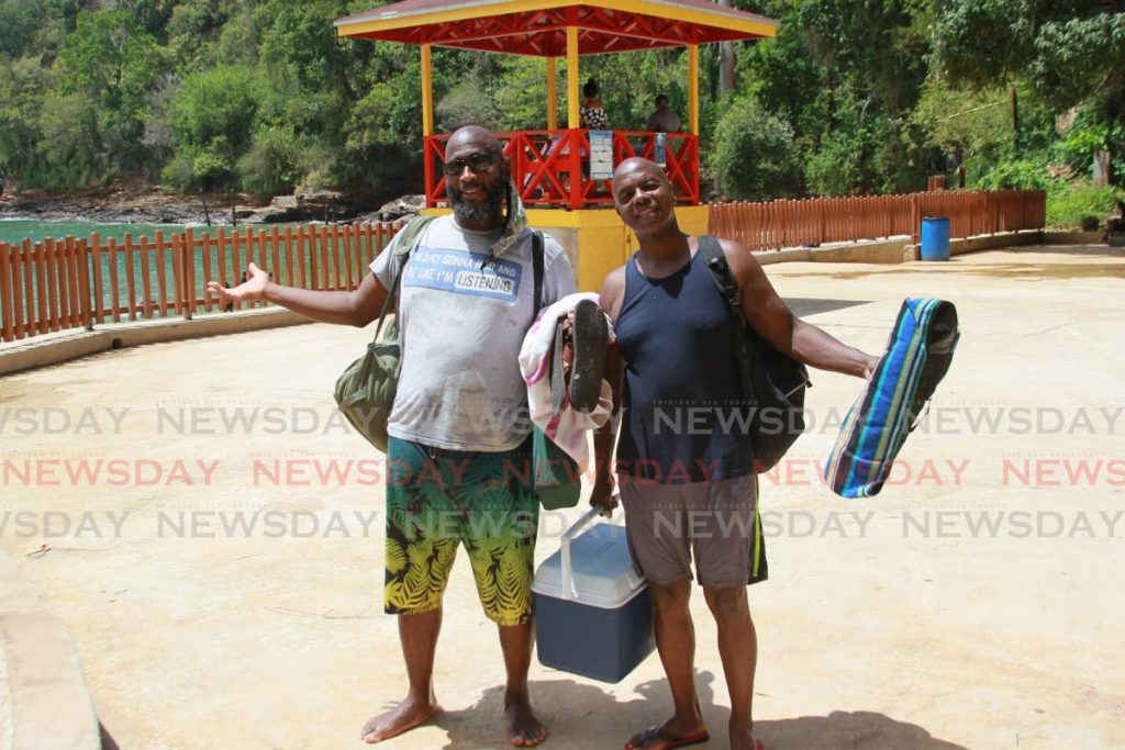 Water was great! Nixon Walker and Reggie Gregg, leave the beach after spend a fun day in the sun, Macqeuripe Beach, Chaguaramas. Photo by Roger Jacob