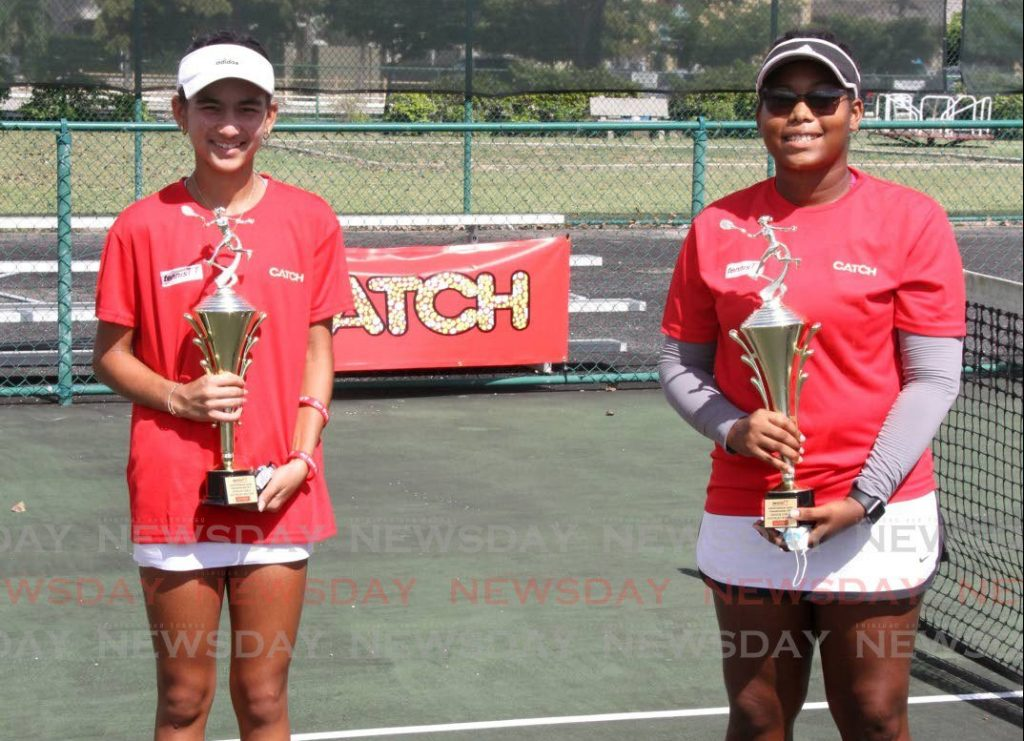 Jordane Dookie (left) and Shauna Valentine, winners of the girls 16-18 doubles category, at the Eddie Taylor Public Courts, Nelson Mandela Park, St Clair on Friday. PHOTO BY ANGELO MARCELLE. - Angelo Marcelle