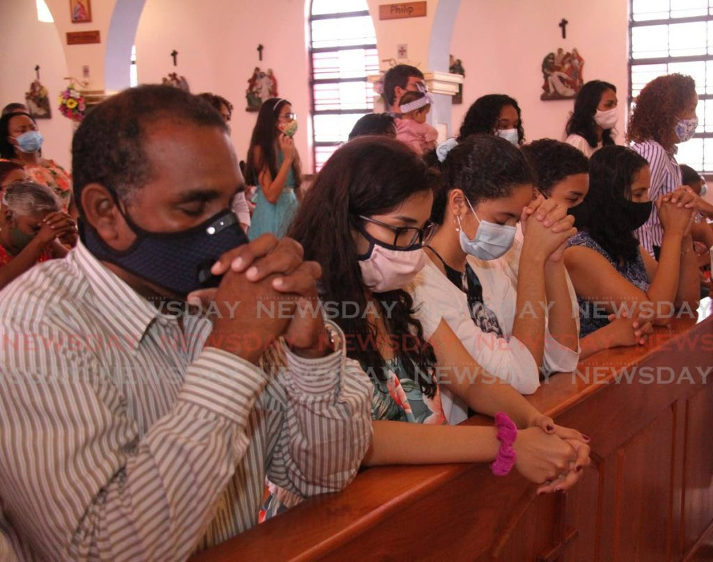 In this April 11 file photo parishioners pray during Easter Sunday mass at Our Lady of Perpetual RC Church, San Fernando. Photo by Angelo Marcelle  -