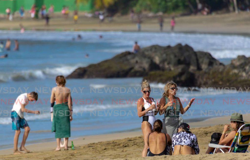 Beachgoers enjoy the water, sand and scenery at Grafton Beach, Black Rock, Tobago on Easter Monday. - David Reid