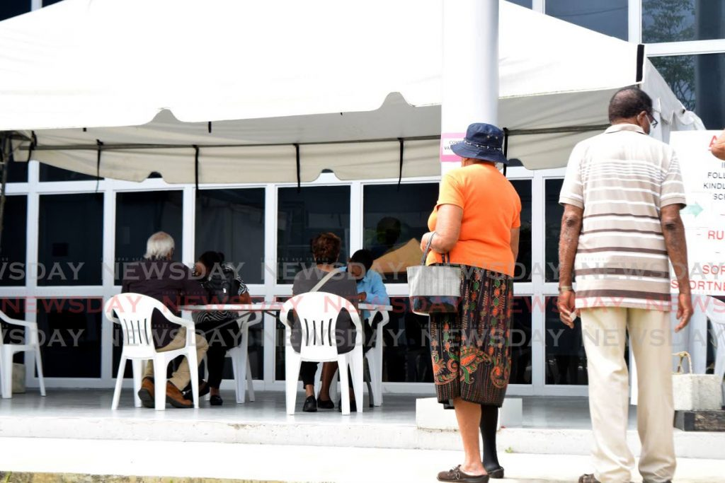 People wait to register for dates to receive the AstraZeneca covid19 vaccine at Diego Martin Health Centre on April 6. Photo by Vidya Thurab -