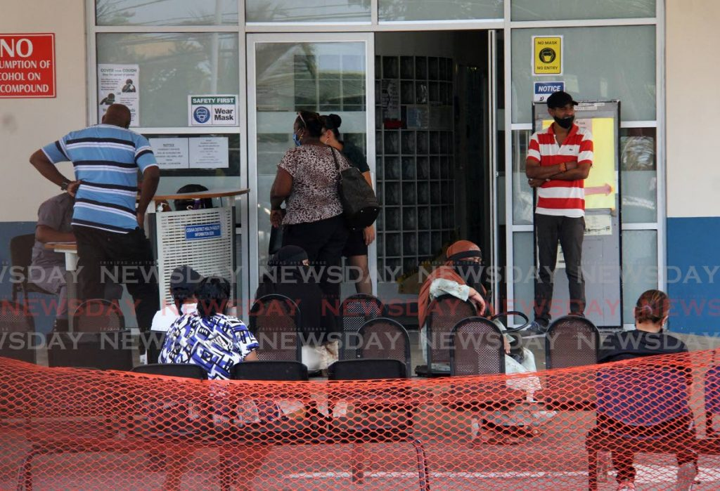 People waiting at the Couva District Health Facility on Tuesday. - Photo by Angelo Marcelle