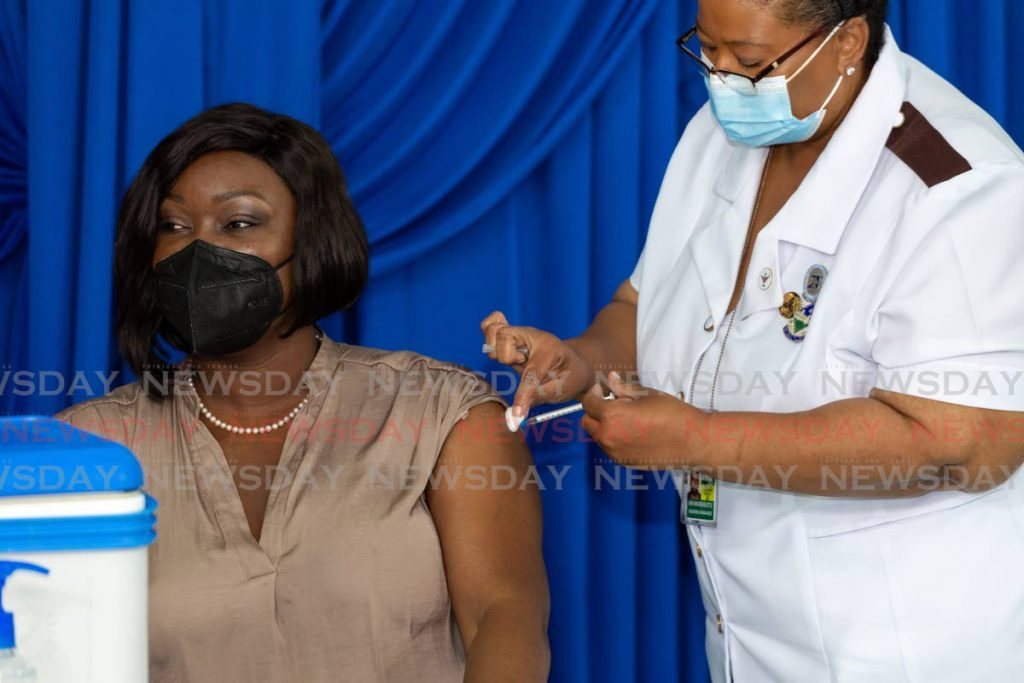 FIRST DOSE: THA Secretary for Health, Wellness and Family Development Tracy Davidson-Celestine receives her covid19 vaccine at the Bacolet Health Centre in Tobago on Tuesday. - DAVID REID