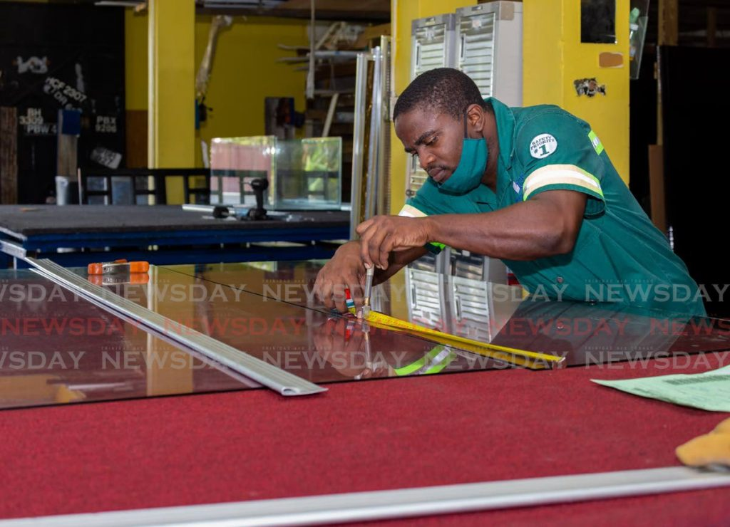 Kevin Gibbs works at Tobago Glass Supplies Ltd Rousseau Trace, Spring Garden, Tobago as a glass cutter. - Photo by David Reid
