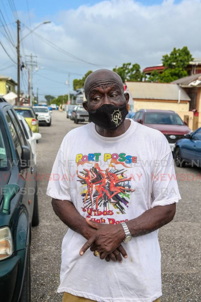 Pensioner and Barataria resident Oswald Duke, 74, spoke to the media after being turned away by public health officials attached to the Barataria Health Centre. He was told they didn't reach his age group as yet.    - Photo by Jeff Mayers