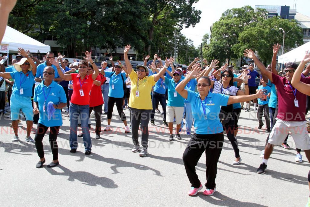 Participants take part in a warm-up exercise for the Diabetes Association of TT's walk at Queen's Park Savannah in November 2017. File photo - CHOLAI