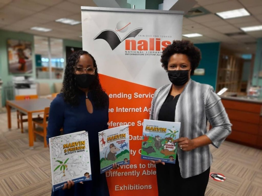 Author Oprah Francis, left, and Cherylann Quamina Baptiste, acting director, Heritage Library Division. -