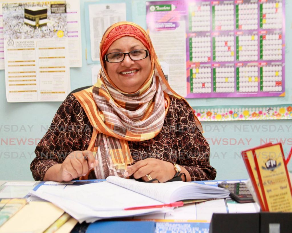 Five Rivers TIA Primary School principal Saleeka Mohammed-Ali in her office last Thursday, getting an early start on plans for the new term which begins on Monday.  -