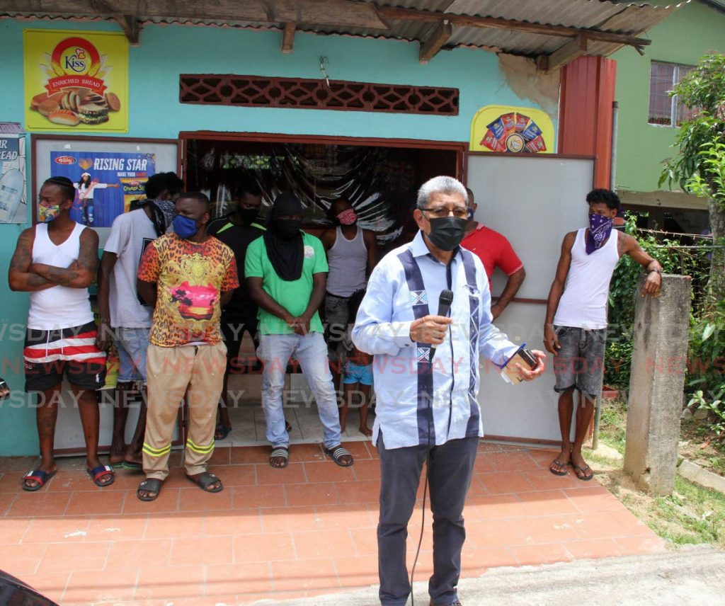 MSJ Political Leader David Abdullah, is joined by residents of Silk Cotton Drive, Marabella on Thursday, to speak about the damage caused by NIQuan Energy Plantś explosion. - Photo by Angelo Marcelle