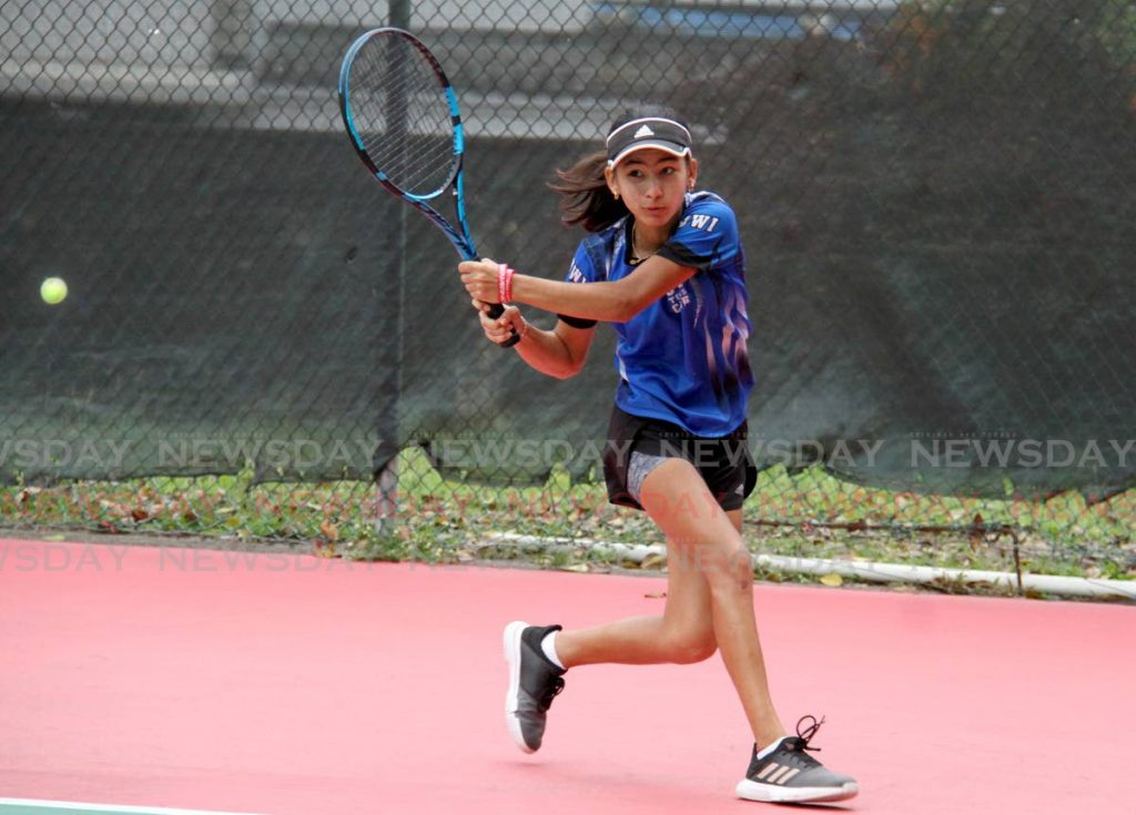 Jordane Dookie during her women's A division singles final match against Aalisha Alexis, in the East Clubs Classified Tennis Tournament, at the Trinidad Country Club, Maraval on Saturday. PHOTO BY AYANNA KINSALE.  - AYANNA KINSALE