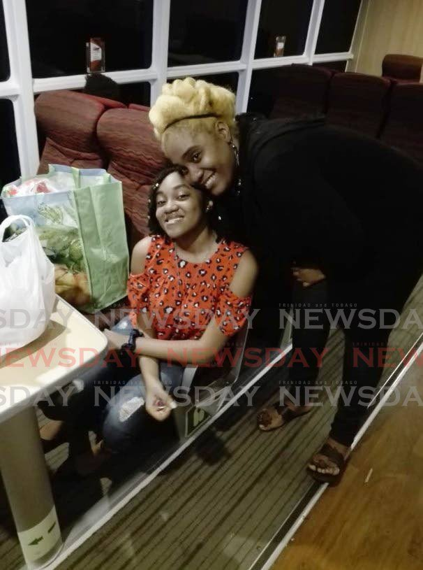 LUCKY ESCAPE: Carla Questelles with her daughter Cashany Forde on board the MV Galleons Passage which left St Vincent on Wednesday en route back home to Trinidad. Three other Trini children were not so fortunate and were left behind in the volcano-hit island. PHOTO BY STEPHON NICHOLAS -