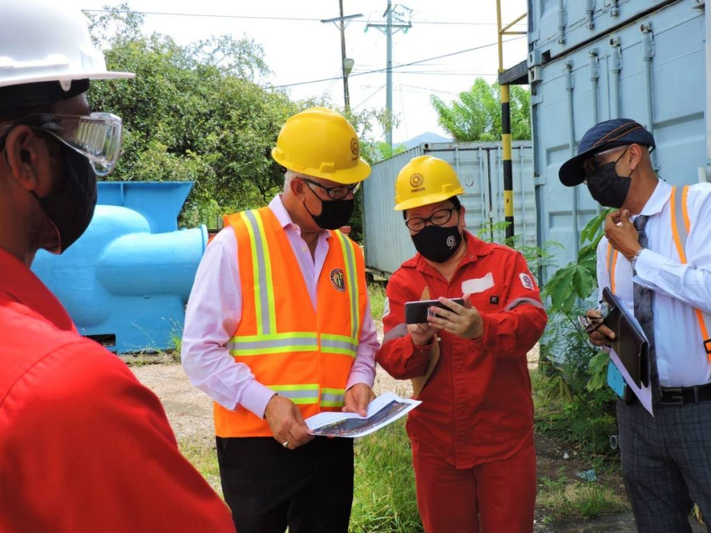 Port of Spain mayor Joel Martinez and representatives of the corporation, PowerGen and the Ministry of Works, discuss potential plans for the PowerGen's cooling water system at the decommissioned Port of Spain Power Station on Wednesday.  -