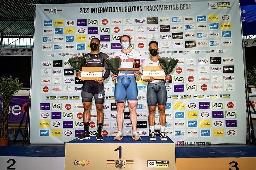 TT's Nicholas Paul, left, celebrates atop the podium after capturing silver in the men's sprint at the International Belgian Track Meeting in Belgium over the weekend. At centre is gold medallist Jason Kenny (Great Britain) and right, third place Surinamese rider Jair Tjon En Fa.  -